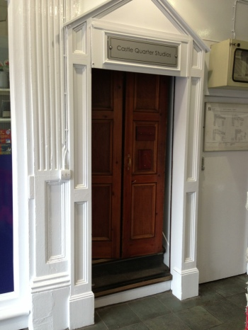 Entrance to the CAFOD South Wales office from Castle Arcade is through the wooden folding door.