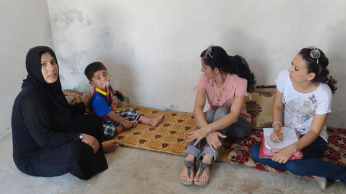 Middle-East-Iraq-mother-sitting-with-three-children_layout-large