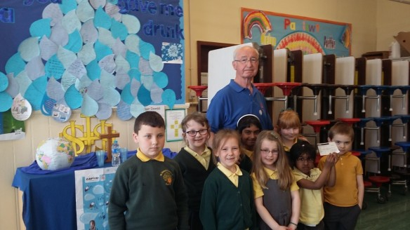 The Chaplaincy Team presenting Mr Coyle with a cheque for £550.