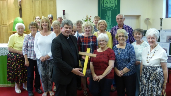 Fr Mansel Usher and OLSS parishioners with Lampedusa Cross