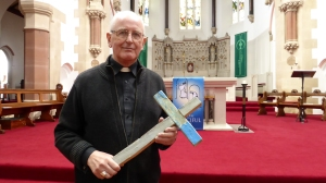 Bishop Tom Burns with the Lampedusa Cross