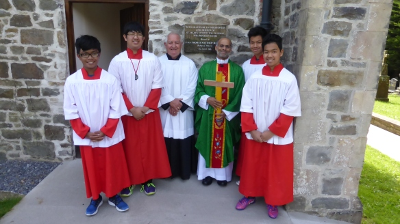 Fr Pius with altar servers and Lampedusa Cross by the Year of Mercy at St Mary's