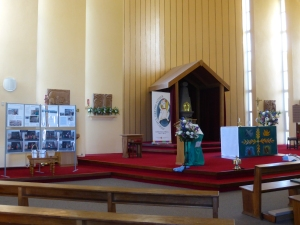 Santuary with YoM display, Year of Mercy poster and Lampedusa cross