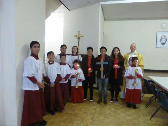 fr-jason-jones-with-servers-and-lampedusa-cross-at-end-of-yr-of-mercy