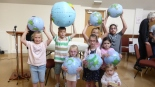 children with globes st helems